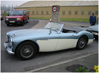 A 3.0 Litre Austin Healey leaving the classic car storage for the weekend